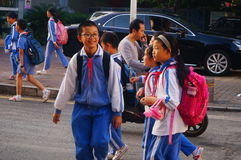 Chinese students home after school through traffic intersection Stock Photography