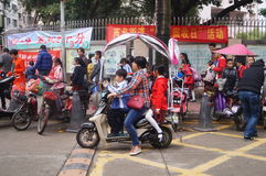 Chinese students at noon on his way home from school Royalty Free Stock Images