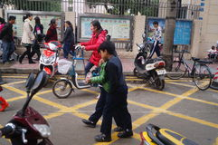 Chinese students at noon on his way home from school Stock Images