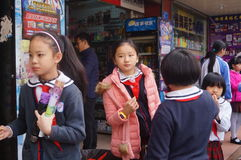 Chinese students at noon on his way home from school Royalty Free Stock Photography