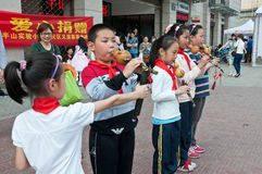Chinese students play cucurbit flute Royalty Free Stock Photos