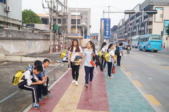 Chinese students on the way home from school Royalty Free Stock Image