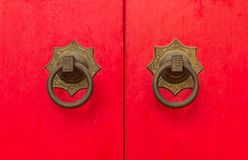 Chinese style Ancient Chinese red door knocker Royalty Free Stock Image