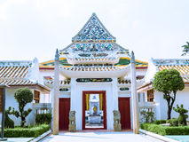 Chinese style arch at the front of Thai Buddhist church. Chinese style arch at the front of Thai Buddhist ancient church Royalty Free Stock Images