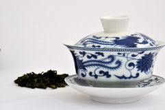 Chinese style blue Painting tea cup and raw tea. A set of Chinese blue painting tea cup and raw tea leaf, refer to chinese traditional culture and tea culture Royalty Free Stock Photos