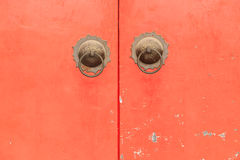 Chinese Style of Brass Ring Pull Handles on Red Door Stock Images
