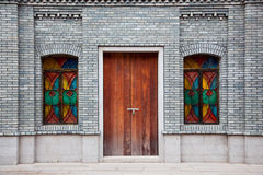 Chinese style building. Detail of old Chinese style building facade with arch doors and colorful windows in a town.This is architectural style in the begin of Stock Photography