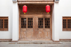 Chinese style building. Detail of old Chinese style building facade with wooden door and  windows in a town.This is architectural style in the begin of last Stock Images