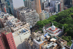 Chinese-style building and mosque tower in Kowloon Royalty Free Stock Photo