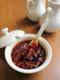 Chinese style chili sauce. With other seasoning bottles Royalty Free Stock Images