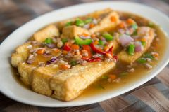 Homemade Chinese style beancurd cuisine. Chinese style cooking of braised beancurd with mince meat Royalty Free Stock Photography