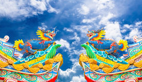 Chinese style dragon statue with blue sky. Royalty Free Stock Photo
