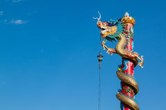 Chinese style dragon statue with blue sky in temple Royalty Free Stock Image