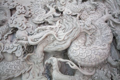 Chinese style dragon statue. And cloud Stock Images