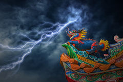 Chinese style dragon statue with lightning storm. Stock Photography