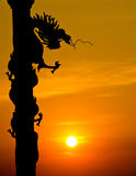 Chinese Style Dragon Statue Silhouette With Sunset Stock Photos