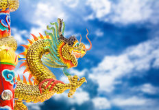 Chinese style dragon statue and sky. Royalty Free Stock Photo