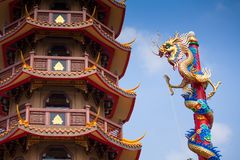 Chinese style dragon statue and temple Stock Photos