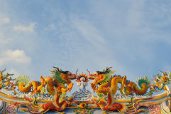 Chinese style dragons on temple's roof. Stock Image