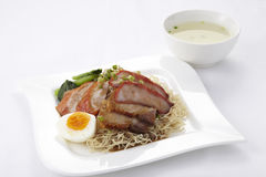 Chinese style egg noodle with roasted duck and pork Stock Photo