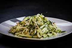 Chinese style entree of zucchini isolated black background. Closeup stock photography