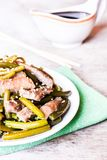 Chinese style fried pork meat with garlic and sesame seeds on a plate, selective focus. Healthy food Stock Images