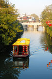 Chinese style garden. Pleasure-boat, red lantern and stone bridge Royalty Free Stock Photos