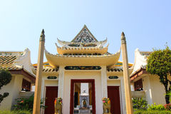 Chinese-style gate guarded by two stone lions at Wat Rajorasaram Royalty Free Stock Image
