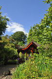 Chinese style gazebo. View showing the  Chinese style gazebo in the Chinese hill garden, Edinburgh Botanic gardens Royalty Free Stock Images