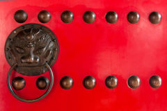 Chinese style handle. On red door Stock Photo