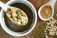 Chinese style hot dessert with green bean mixed with job`s tears boil stock image