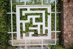 Chinese style iron fence, natural trees in the garden Beautiful. Chinese style iron fence, natural trees in the garden Beautiful cement walkway stock photos