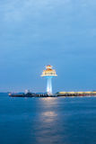 Chinese style lighthouse and twilight sky at Koh Sichang,Chonburi province,Thailand. Stock Photos