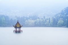 Chinese style pavilion in the middle of lake. With fog Stock Photo