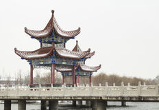 Chinese style pavilion in the snow Stock Photos