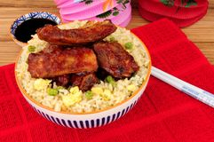 Chinese Style Pork Ribs With Egg Fried Rice royalty free stock photo