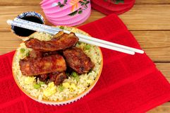 Chinese Style Pork Ribs With Egg Fried Rice royalty free stock image
