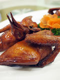 Chinese style roasted pigeon. Roasted pigeon in Chinese cuisine Stock Image