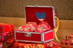 Chinese style safe furniture for wedding. Luxury red handle box on wood table. royalty free stock photo