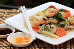 Chinese style stir fried yellow noodles with in gravy sauce Stock Image