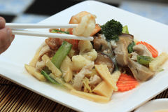 Chinese style stir fried yellow noodles with in gravy sauce Royalty Free Stock Photo