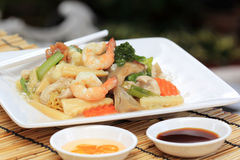 Chinese style stir fried yellow noodles with in gravy sauce Stock Photography