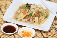 Chinese style stir fried yellow noodles with in gravy sauce Stock Photos