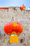 Chinese style stone wall and red paper lantern. royalty free stock image