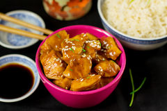 Chinese style sweet and sour chicken with sesame seeds. And rice Stock Photo