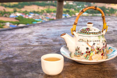 Chinese style teacup and teapot with green tea Stock Photo