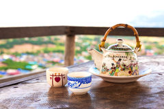 Chinese style teacup and teapot with green tea Stock Image