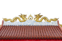 Chinese style twin golden dragons on the roof Stock Photography