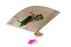 A chinese style wooden fan. Decorative fan on a white background Stock Images