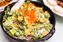 Chinese styled salad with corn flakes and fish eggs topping Stock Images